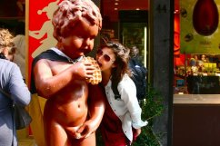 """Posing with a """"Manneken Pis"""" themed statue outside a waffle restaurant in Brussels, Belgium (@kmtwanderlust photo/May 6, 2011)"""