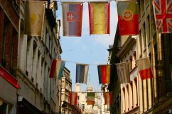 Flags hang along a street in Brussels, Belgium (@kmtwanderlust photo/May 6, 2011)